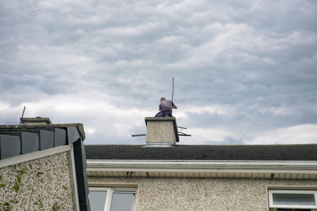 man on the chimney top
