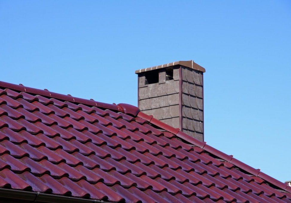 a galvanized red roof with chimney